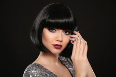 Beauty Makeup, Silver Manicured polish nails. Bob hairstyle. Fashion Style Brunette Woman Portrait with black Short Hair and. Glitter lips isolated on black royalty free stock photo