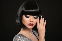 Beauty Makeup, Silver Manicured polish nails. Bob hairstyle. Fashion Style Brunette Woman Portrait with black Short Hair and. Glitter lips isolated on black stock image