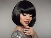 Beauty Makeup, Silver Manicured polish nails. Bob hairstyle. Fashion Style Brunette Woman Portrait with black Short Hair and. Glitter lips isolated on gray royalty free stock image