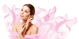 Beauty Makeup Skin Care, Woman Touching Face by Hand, Young Girl in Pink. Waving Cloth over White stock images