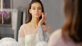 Beauty makeup skincare cosmetics girl lifestyle. Beauty makeup skincare cosmetics. young beautiful girl lifestyle. confident woman applying cream stock footage