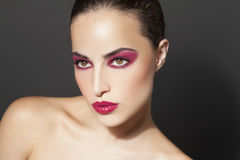 Beauty and makeup. Woman with attractive red makeup, beauty portrait, studio closeup Royalty Free Stock Photos