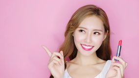 Beauty make up woman. Beauty makeup woman smile to you with lipstick and show something Stock Images