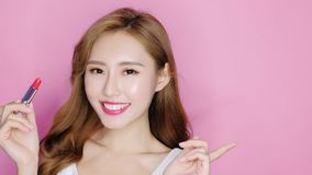 Beauty make up woman. Beauty makeup woman smile to you with lipstick and show something Stock Photography