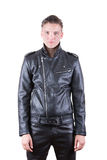 Beauty male model portrait wear black leather jacket and pants, young guy over white isolated background. Handsome fashion man, beauty male model portrait wear Stock Photography