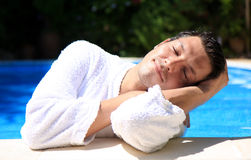Beauty man. Beauty smiling man dreaming in the pool Royalty Free Stock Photo