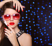 Beauty. manicured nails. Fashion model girl in sunglasses with b royalty free stock photography