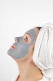 Beauty mask #17. Attractive woman with blue beauty mask on white background Stock Image