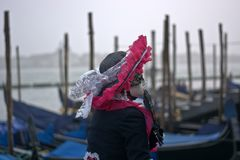 The masks at Piazza San Marco on a foggy day in Venice stock photography