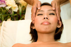 Beauty Massage. A young Asian woman having her head massaged in a salon Royalty Free Stock Images