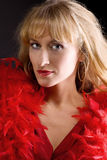 Beauty mature woman in red boa Royalty Free Stock Image