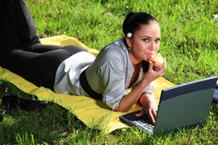Beauty on meadow with computer Stock Photos