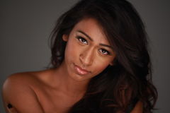 Beauty model. With soft light over a dark background royalty free stock photo
