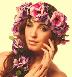 Beauty model beautiful woman face close-up , wreath flowers her Stock Image