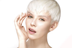 Beauty model blonde short hair showing perfect skin Stock Photography