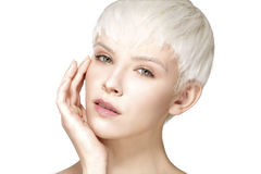 Beauty model blonde short hair showing perfect skin Royalty Free Stock Images