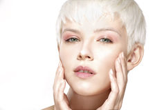 Beauty model blonde short hair showing perfect skin Royalty Free Stock Photos