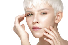 Beauty model blonde short hair showing perfect skin Royalty Free Stock Photo