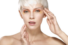 Beauty model blonde short hair showing perfect skin Stock Image