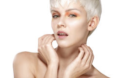 Beauty model blonde short hair showing perfect skin Royalty Free Stock Photography