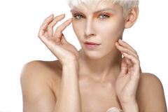Beauty model blonde short hair showing perfect skin Royalty Free Stock Image