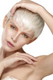 Beauty model blonde short hair showing perfect skin Stock Images