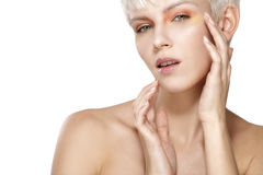 Beauty model blonde short hair showing perfect skin Stock Photos