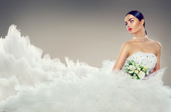 Beauty model bride in wedding dress with long train. Beautiful fiancee in elegant white wedding dress Stock Images