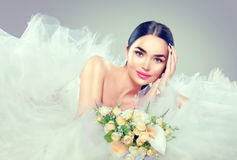 Beauty model bride in wedding dress with long train Stock Photography