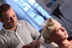 Beauty model getting hair ready Royalty Free Stock Photo