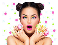 Beauty model girl with with colorful macaroons Royalty Free Stock Images