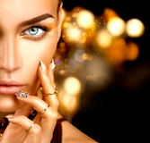 Beauty model girl with golden makeup Royalty Free Stock Photos