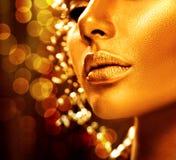 Beauty model girl with golden skin stock photos
