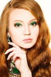 Beauty Model Girl with Makeup and Red Hair Royalty Free Stock Image