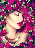 Beauty model girl with pink roses flower wreath and fashion makeup Royalty Free Stock Photography