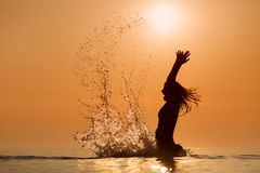 Beauty Model Girl Splashing Water With Her Hands. Teen Girl Swim Royalty Free Stock Images