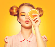 Beauty model girl takes juicy oranges Royalty Free Stock Photography