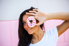 Beauty  model girl taking sweets and colorful donuts Royalty Free Stock Photo