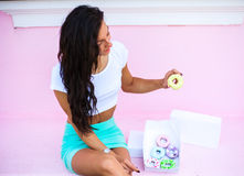 Beauty  model girl taking sweets and colorful donuts Stock Photography