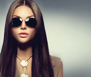 Beauty model girl wearing sunglasses. Beauty model girl with long brown hair wearing sunglasses Royalty Free Stock Photos