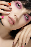 Beauty model hairstyled  and pink eye shadows makeup  closeup Stock Photos