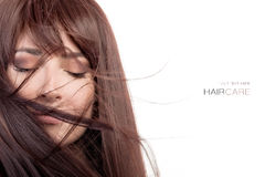 Beauty model with healthy long hair blowing over face Stock Images