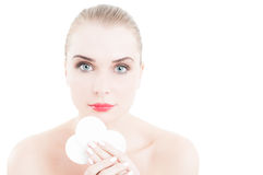 Beauty model holding face cleaner disc. Isolated on white background royalty free stock photo