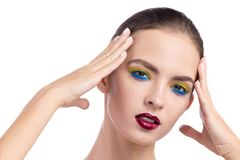 Beauty model holds her head in her hands royalty free stock images