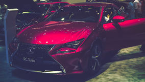 Beauty Model and Lexus RC Turbo car on display at Vietnam motor Show 2017 Royalty Free Stock Photography