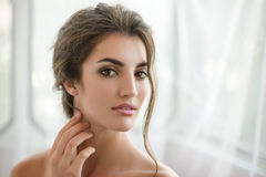 Beauty model with  make up and fresh skin is posing front of the Royalty Free Stock Images