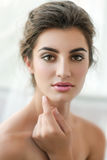 Beauty model with  make up and fresh skin is posing front of the Royalty Free Stock Image