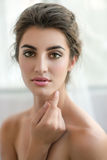 Beauty model with  make up and fresh skin is posing front of the Royalty Free Stock Photography