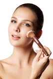 Beauty model with makeup brush. Bright make-up for brunette woma Stock Photography