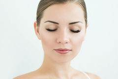Beauty Model with  Perfect Fresh Skin and Long Eyelashes. Stock Photo